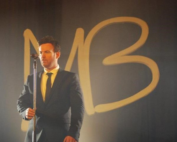 Michael Buble tribute act performing on stage