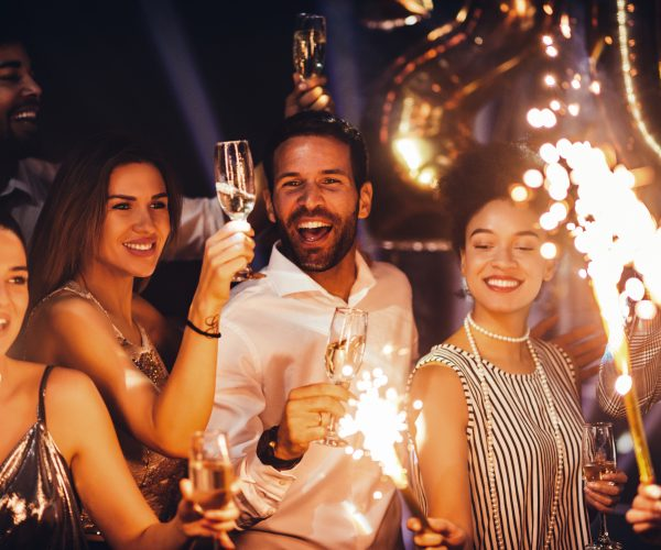 Friends celebrate together with champagne and sparklers