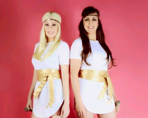 The two women from the ABBA tribute dressed in typical ABBA outfits