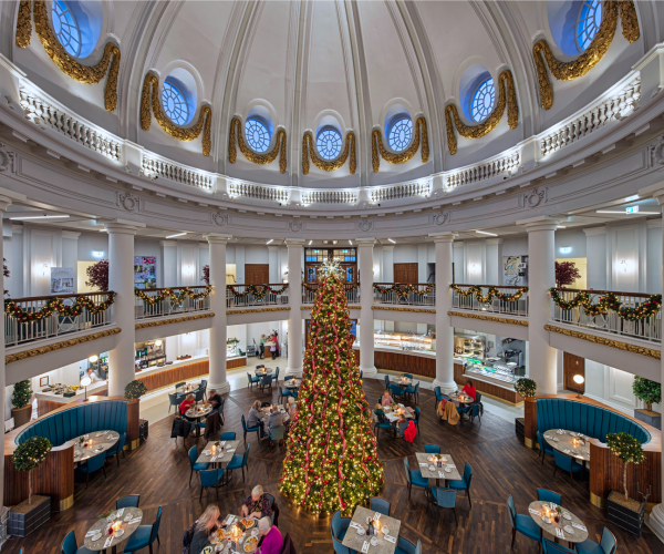 Dinners enjoy dinner in Trenchers. There is a big Christmas tree in the middle of the room reaching up to the Dome.