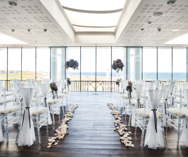 St Mary's Lighthouse Suite at Spanish City dressed for a wedding ceremony