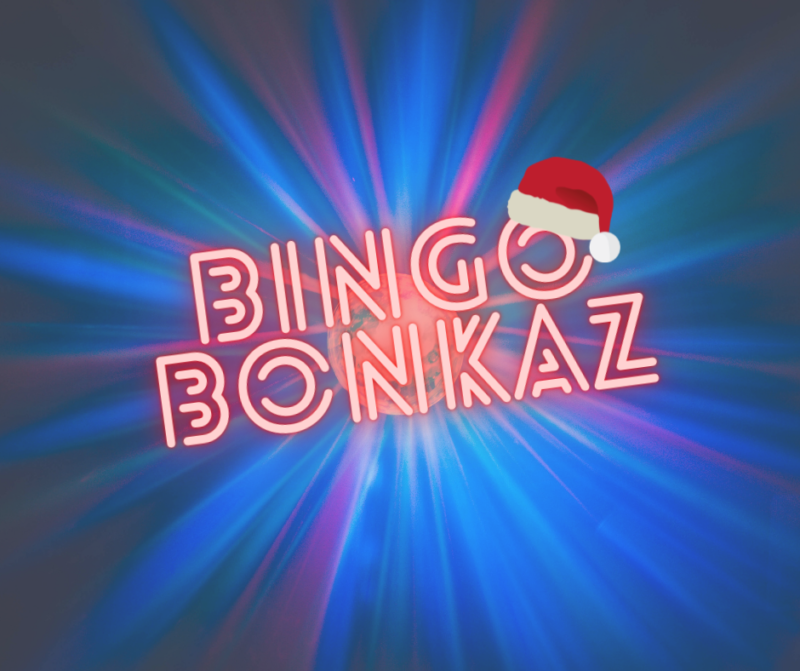Bingo Bonkaz in fluorescent lights with a santa hat on the O