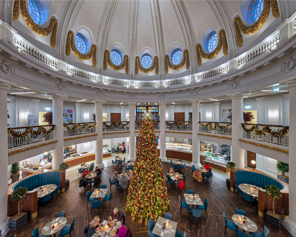 Diners in Trenchers sit around the 40ft christmas tree